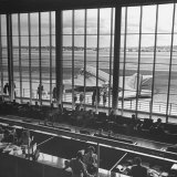 People Watching the Arrival and Departure of Airplanes in National Airport's Terminal Building Photographic Print by Hans Wild