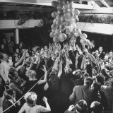 People Reaching For the Balloons at the Palm Beach Party Photographic Print by Herbert Gehr