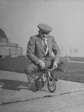 Humorous of Man Riding Tiny Bicycle Premium Photographic Print by Wallace Kirkland