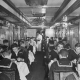 G.I. Personnel and Their Wives Eating in Dining Car While Civilians Will Have to Wait Until Later Photographic Print by Sam Shere