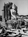Convoy Truck Drivers Standing Around Wrecked Buddha Premium Photographic Print by Jack Wilkes