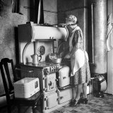 Woman Cooking on Old Fashioned Stove Photographic Print by Walter Sanders