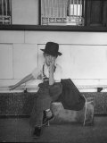 Little Boy Sitting on His Luggage While Waiting For the Train at the Denver Union Station Premium Photographic Print by Sam Shere
