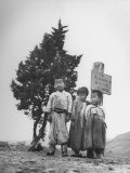 Children Standing in Front of Boundary Zone Marker Written in Russian, English, and Korean Premium Photographic Print by John Florea