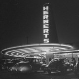 Cars Sitting Outside of a Drive in Restaurant Photographic Print by Nina Leen