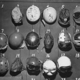 Jet Pilot Helmets and Goggles Hanging on Hooks Photographic Print by Charles E. Steinheimer