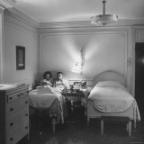Vern Tobias and His Wife Eleanor, Eating in Bed While on Their Honeymoon Photographic Print by Sam Shere