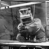 Sculptor W. G. Lowry Sandblasting Glass Into a Sculpture Photographic Print by Francis Miller