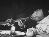 Customer Smoking Opium in an Opium Den Premium Photographic Print by George Lacks