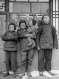 Family Standing Outside Their One Room Abode Premium Photographic Print by George Lacks