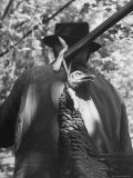 Hunter Carrying Dead Turkey Hung from His Rifle Premium Photographic Print by Gabriel Benzur