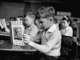 Child Reading a Book in School Premium Photographic Print by Frank Scherschel