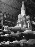 Dust Covered Wine and Brandy Bottles Lying on Racks in a Wine Cellar Lámina fotográfica de primera calidad por Nina Leen
