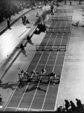 Four Runners Clearing Hurdles in 60 Yard Dash at Mellrose Games Photographic Print by Gjon Mili
