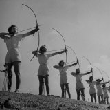 Girls Practicing Archery Photographic Print by John Florea