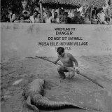 Alligator Wrestler Working at an Indian Village Photographic Print by Eliot Elisofon