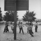 Pueblo Boys Playing a Game of Basketball Photographic Print by Peter Stackpole