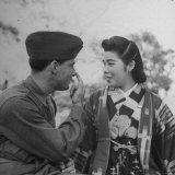 GI Teaching a Japanese Girl How to Speak in English in the Park Photographic Print by John Florea