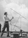 Comparing Television Sentinel Portable Antenna with Permanent Roof Installations Photographic Print by George Skadding