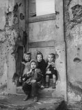 Little Girls Sitting on a Doorstep Together Premium Photographic Print by Nat Farbman