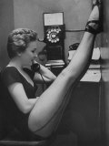Dancer Mary Ellen Terry Talking with Her Legs Up in Telephone Booth Photographic Print by Gordon Parks