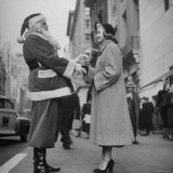 Secretary Eileen Godsil Talking with a Department Store Santa Claus on 5th Avenue Photographic Print by Martha Holmes