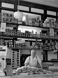 Butcher Standing at Meat Counter of Deli Premium fotoprint van Alfred Eisenstaedt