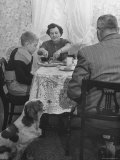 Kid Football Player Having Dinner Premium Photographic Print by Francis Miller