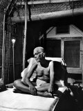 Holy Man Sri Ramana Maharshi Sitting in Bed Premium Photographic Print by Eliot Elisofon