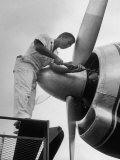 Eastern Airline Employees Working on the Maintaining an Aircraft's Engine Photographic Print by Ralph Morse