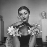 Model Wearing a Flowery Glove While Peering Into the Distance Photographic Print by Nina Leen