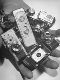 Micro Cameras Resting in Palm of Hand Premium Photographic Print by Andreas Feininger