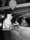 "Car Hop ""Bunny"" Wearing $128 Parka Uniform Serves a 75 Cent Hamburger Premium Photographic Print by George Silk"