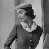 Model Wearing Tweed Suit and White Plush Hat Photographic Print by Nina Leen