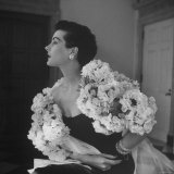 Model Wearing a Flowery Dress While Peering Into the Distance Photographic Print by Nina Leen