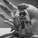 Micro Camera Resting in Palm of Hand Photographic Print by Andreas Feininger