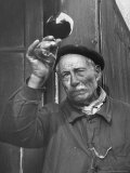 French Man Looking at How Clear the Wine Is Premium Photographic Print by Thomas D. Mcavoy