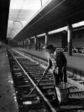 African American Woman Picking Up Debris on Tracks at Union Station Premium Photographic Print by Alfred Eisenstaedt