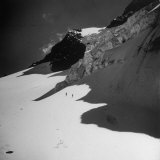 Climber Making Their Way Across a Snow Field Near Top of Mountain in Albert National Park Photographic Print by Eliot Elisofon
