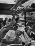 Carol Fleckles Cooling Off Her Feet as Girls Doze En Route from Lucerne to Visp on a Hot Afternoon Premium Photographic Print by Nat Farbman