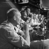 Men Gathered Around For Their Weekly Meeting Indulging in Glasses of Beer Photographic Print by Frank Scherschel