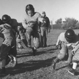Kid's Football Photographic Print by Francis Miller