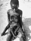 Baby Gorilla Named Bobo is Being Held by a Local Youngster Premium Photographic Print by Eliot Elisofon