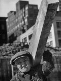 Construction Worker Carrying a Piece of Wood Premium Photographic Print by Cornell Capa