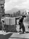 Boys Working in Pasta Factory Carry Rods of Pasta to Drying Rooms Premium fotoprint van Alfred Eisenstaedt
