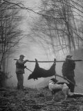 Jim Atchley and Dr. Ray Atchley Carrying Boar That They Killed Photographic Print by Ralph Crane