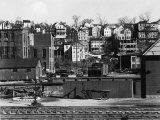 Houses Overlooking Railroad Tracks Premium Photographic Print by Jack Delano