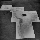 Man Works on Map of Latin and South America under Supervision of Political Geographer Isaiah Bowman Photographic Print by Alfred Eisenstaedt