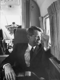 Attorney General Robert F. Kennedy Traveling by Plane Impresso fotogrfica premium por George Silk