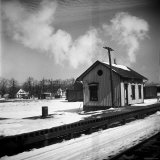 Small Railroad Station in Unidentified American Town, as Seen from Train Window Photographic Print by Walker Evans